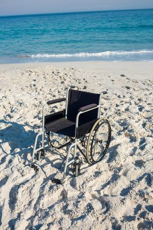 paraplegic: Black wheelchair on the beach