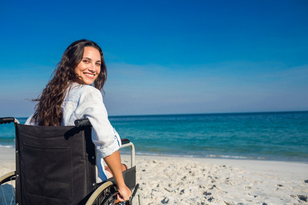 Disabled woman looking at camera on a sunny day Stockfoto