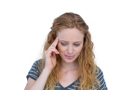 wincing: A blonde woman having headache on white background Stock Photo