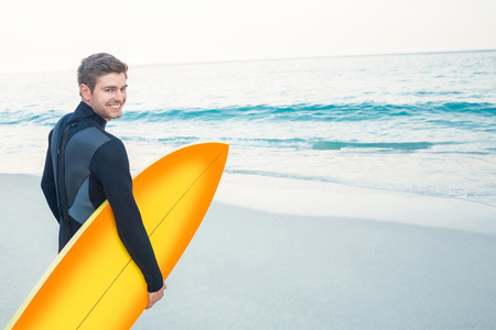 wetsuit: Man in wetsuit with a surfboard on a sunny day