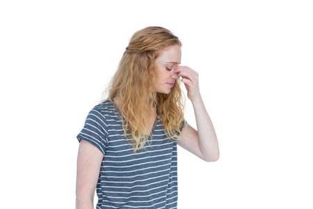 pinching: Woman with headache pinching her nose on white background