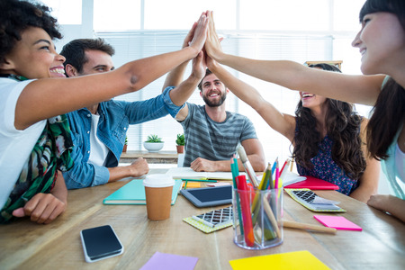 team success: Creative business team putting hands together at the office Stock Photo