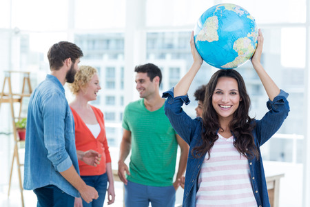 business globe: Young creative business people with a globe in the office Stock Photo