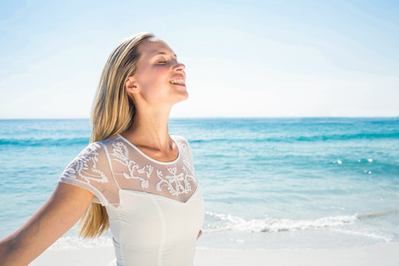 happy woman smiling at the beach Stock Photo