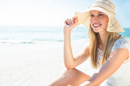 escapism: beautiful blonde woman on a sunny day at the beach