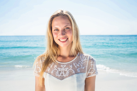 woman freedom: happy woman smiling at the beach Stock Photo