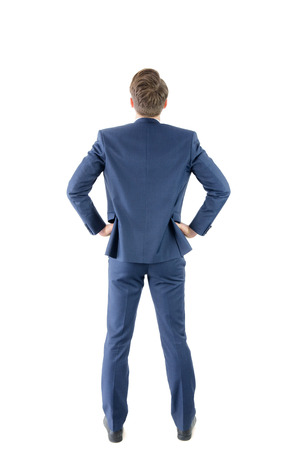 hands on hip: Wear view of businessman with hands on hip on white background Stock Photo