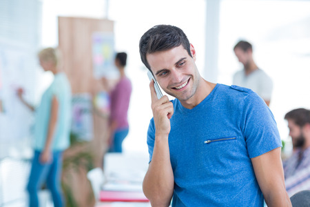 Casual businessman on the phone in the office Stock Photo