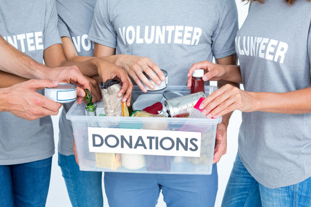 foodstuffs: Volunteers friends separating foodstuffs Stock Photo