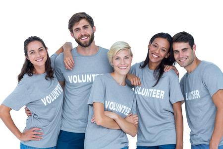 volunteer: Happy volunteers friends smiling at the camera