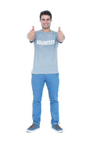 selfless: Handsome volunteer man gesturing thumbs up Stock Photo