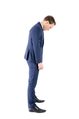 defeated: Defeated businessman looking at his shoes on white background Stock Photo