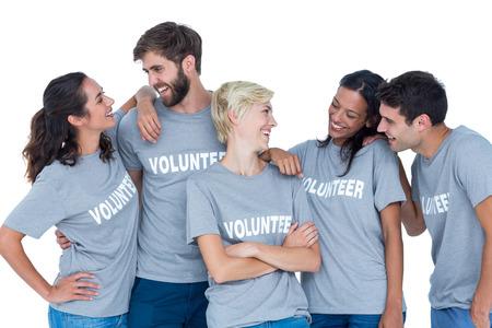 Happy volunteers talking together Stock Photo