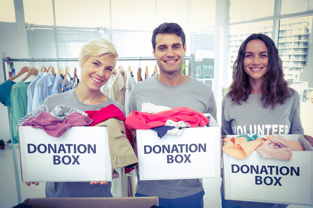 donation: Happy volunteers friends holding donation boxes