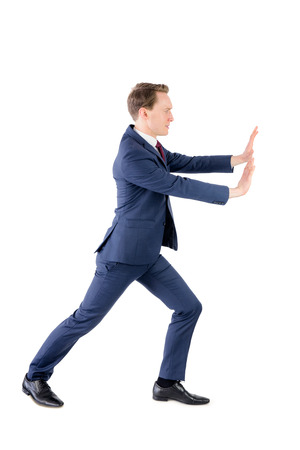 A businessman pushing something on white background