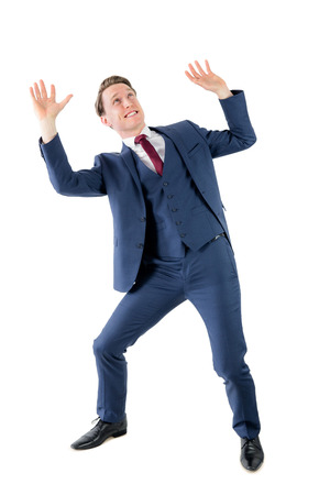 taken: A surprised businessman holding something on white background