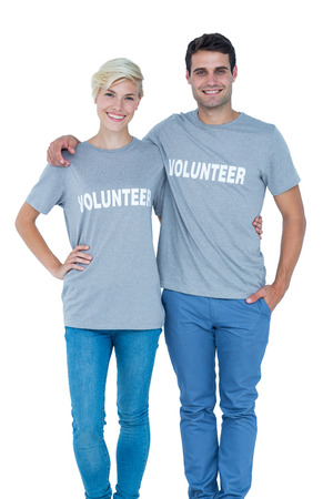 selfless: Cute couple of young volunteers holding themselves