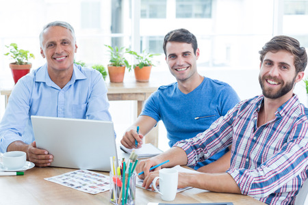 casual business: Casual business team having a meeting in the office Stock Photo