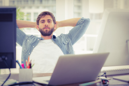 career young: Relaxing businessman lying in chair in the office