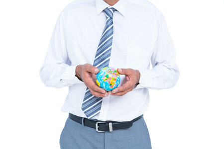businessman carrying a globe: image of businessman holding earth against white screen