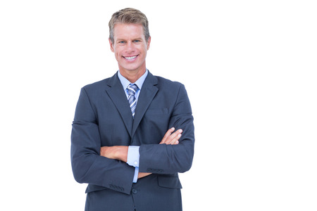 mature business man: Smiling businessman with arms crossed against a white background Stock Photo