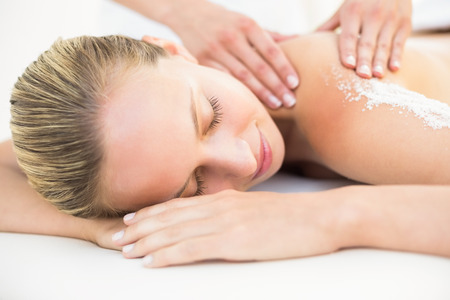 massage  table: High angle view of a beautiful young woman lying on massage table at spa center