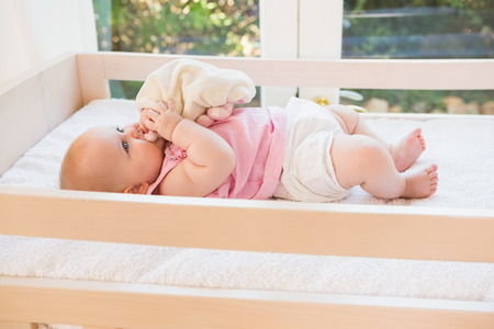 domiciles: Beautiful cute baby girl in her crib at home in bedroom