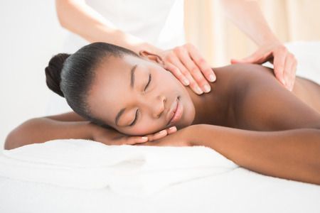 woman laying: Pretty woman enjoying a massage at the health spa