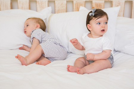 baby sit: Very beautiful cute babies boy and girl at home in bedroom