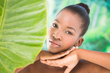 greenness: Close up view of a beautiful young woman over greenness background Stock Photo