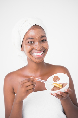 chocolate mask: Portrait of a woman holding a chocolate bowl at spa center