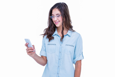 geeky: Pretty geeky hipster using her smartphone on white background Stock Photo