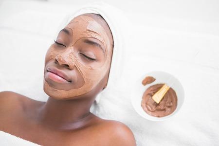 hair treatment: Pretty woman enjoying a chocolate facial treatment at the health spa