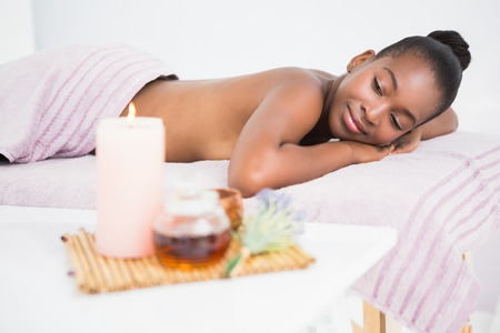 massage  table: Pretty woman lying on massage table at the health spa Stock Photo