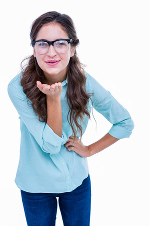 geeky: Pretty geeky hipster sending kiss to camera on white background Stock Photo