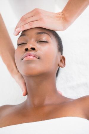 reiki: Pretty woman enjoying a reiki technique at the health spa