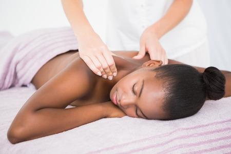 body spa: Pretty woman enjoying a massage at the health spa