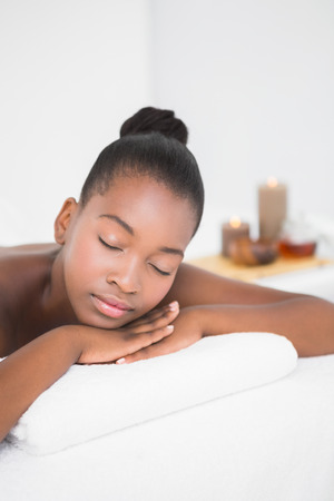 massage  table: Peaceful pretty woman lying on massage table at the health spa Stock Photo