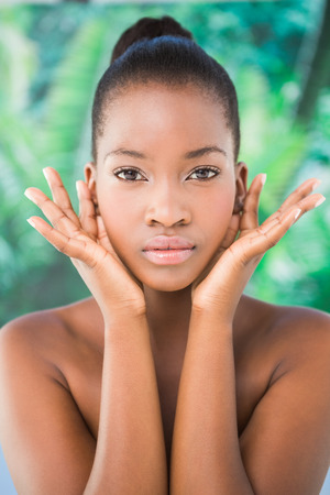 greenness: Portrait of a pretty woman gesturing in front of the camera on a greenness background Stock Photo