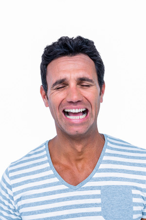 dreariness: Sad man is crying on white background