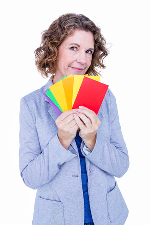 graphic designing: A businesswoman holding colors cards on white background