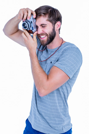 take time out: Happy handsome man taking pictures on white background Stock Photo