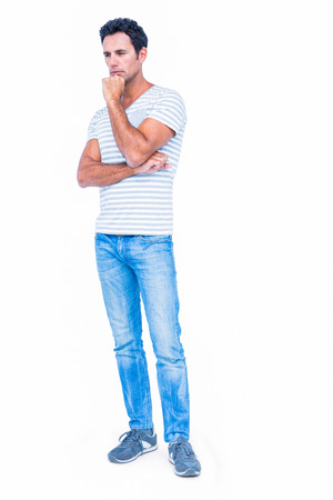 hand on the chin: Thoughtful man with hand on chin on white background