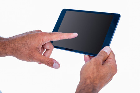 fourties: Hand of man touching tablet computer on white background