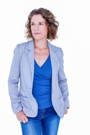 hands on pocket: Businesswoman standing with hands in pocket on white background