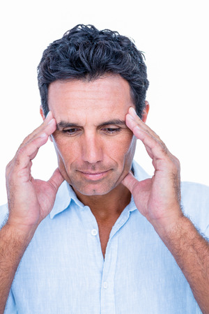 hand on forehead: Handsome man thinking with hand on forehead on white background