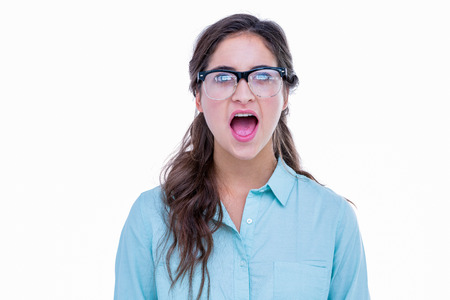 geeky: Surprised geeky hipster with her mouth open on white background Stock Photo