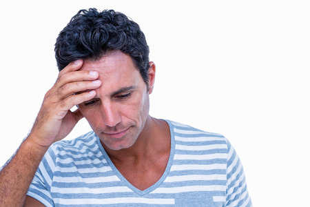 one hand: Sad man with one hand on head on white background Stock Photo