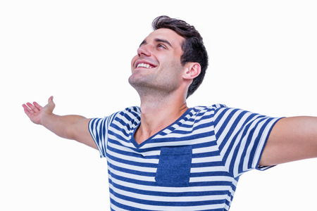 Handsome hipster with arms outstretched on white background