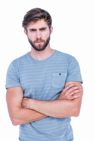 arm: Unhappy handsome man looking at camera with arms crossed on white background